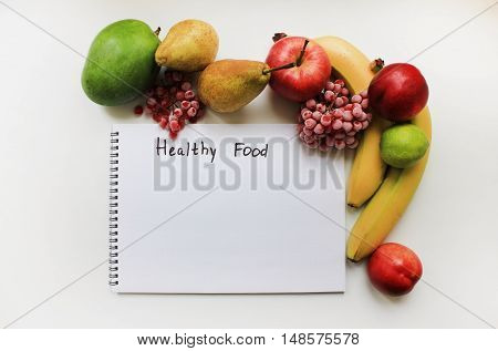 Healthy food: organic fresh fruits apple banana pear peach mango berries isolated on white table. Colorful  background diet fitness planning, healthy eating food nutrition sport lifestyle concept with empty copy space for text close up