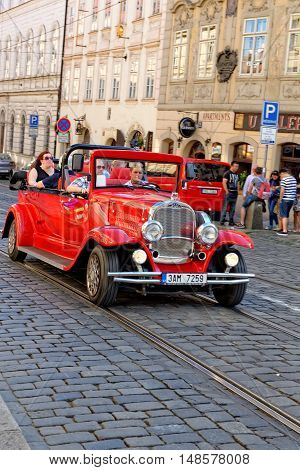 PRAGUE CZECH REPUBLIC - JULY 3 2014: Tour of the city on an old car in motion. Prague is the capital and largest city of the Czech Republic.