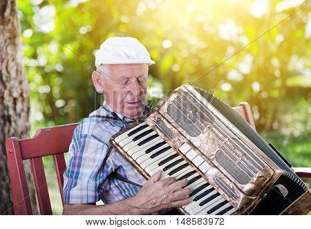 Old Man Playing Accordion