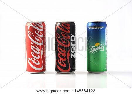 Bangkok, Thailand - September 23, 2016: Coca-Cola, Fanta and Sprite Cans Isolated On White. The three drinks produced by the Coca-Cola Company are the worlds best sold refreshing drinks.