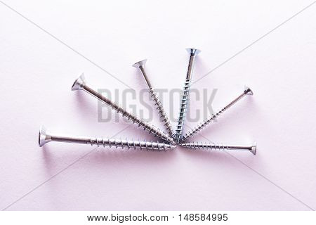 Different Size Screws Radial Pattern White Background Metal