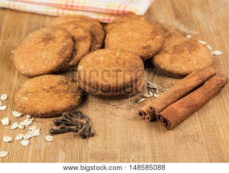 Cookies honey with nuts, oat flakes, cinnamon and cloves on a wooden surface