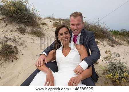 Cheerful And Loving Married Couple Standing On The Sand