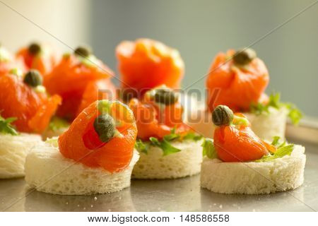 Salmon canapes at party table, food concept
