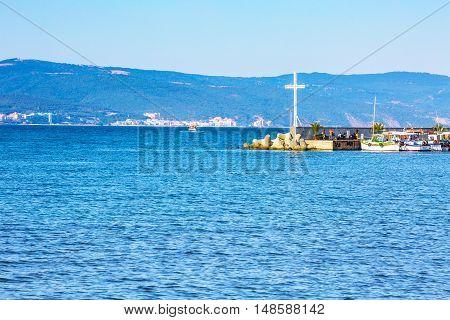 Nessebar, Bulgaria - July 25, 2016: Cross, port and boats view in Nesebar in Bulgaria