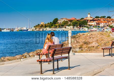 Nessebar, Bulgaria - July 25, 2016: Couple looking at old town panorama in Nessebar or Nesebar in Bulgaria, Black sea