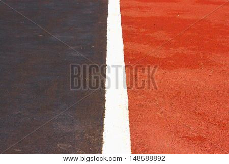 Red and blue running track in stadium.