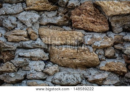 Old brick wall stone background in the village