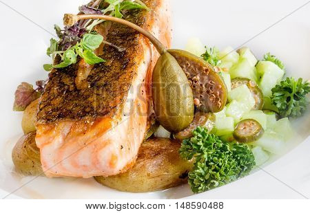 Fried salmon with potatoes the seafood& capers