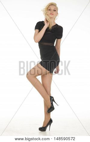 beautiful young attractive blonde women wear black dress in studio