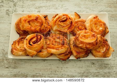 Savory puff pastries spiral shaped filled cheese