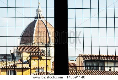 Cattedrale di Santa Maria del Fiore behind the window Florence Tuscany Italy. Cultural heritage. Architectural theme.