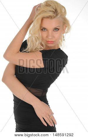 young pretty blonde fashion model in studio