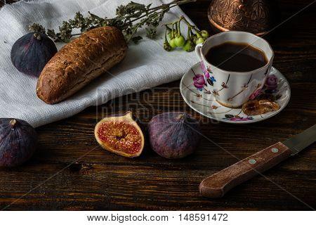 Light breakfast with hot coffee multigrain bread and few ripe juicy figs.