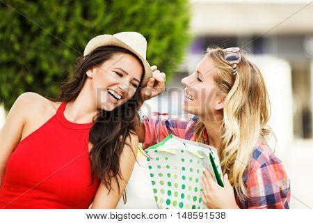 Two beautiful girls having fun in shopping.