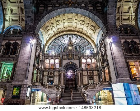 ANTWERP, BELGIUM - 10 SEPT. 2016: Inside the main hall of the Central Railway Station in Antwerp, Belgium with view on the stairs and clock. It is considered one of the most beautiful in Europe.