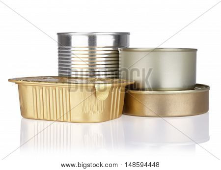 tins of different sizes without labels canned food on a white background with reflection