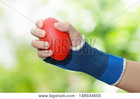 patient 's woman hand squeezing a stress balls