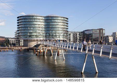 Copenhagen, Denmark - September 23, 2016: Modern cyclist bridge Bryggybroen and the Gemini Residence