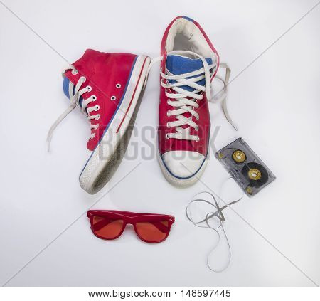 Old red sneakers, red glasses and tape