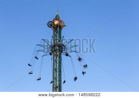 Copenhagen, Denmark - September 23, 2016: A merry-go-round tower in the Tivoli Gardens amusement park