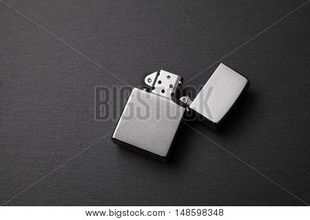 gasoline lighter metal lighter on a dark background