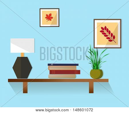 Interior. Furniture. Shelves on the beige wall with pictures, lamp, plant and book.