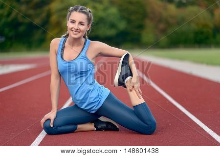 Happy Fit Young Woman Doing Stretching Exercises