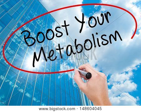 Man Hand Writing Boost Your Metabolism With Black Marker On Visual Screen