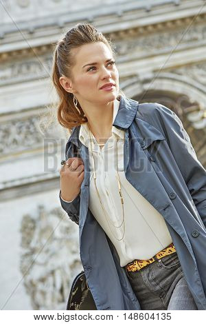Woman Near Arc De Triomphe In Paris, France Looking Aside