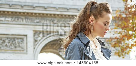 Pensive Modern Woman Near Arc De Triomphe In Paris, France