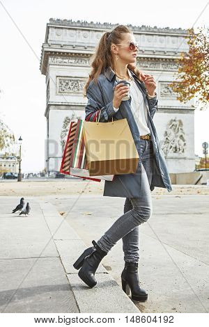 Woman Shopper Near Arc De Triomphe Having Coffee And Macaroon