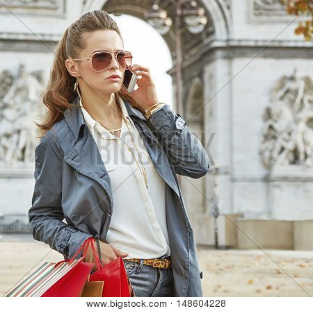 Fashion-monger Near Arc De Triomphe In Paris Using Mobile Phone
