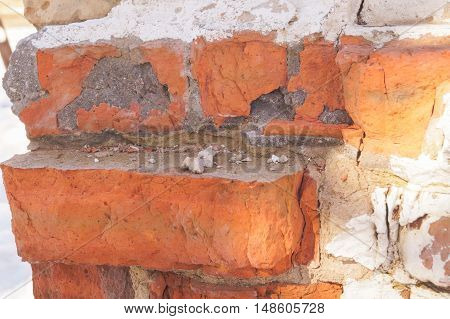 Textured Background Or Studio Backdrop Of Decayed Old Red And White Bricks In The Outdoor