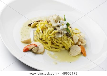 Pasta Dish Tagliolini with scallops and mushrooms