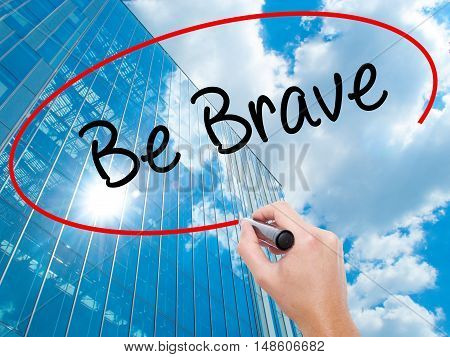 Man Hand Writing Be Brave With Black Marker On Visual Screen