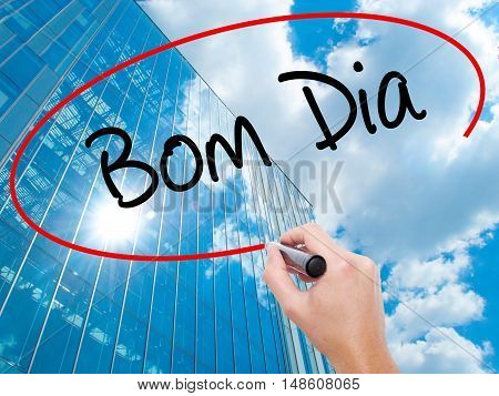 "Man Hand Writing ""bom Dia"" (in Portuguese - Good Morning)  With Black Marker On Visual Scr"