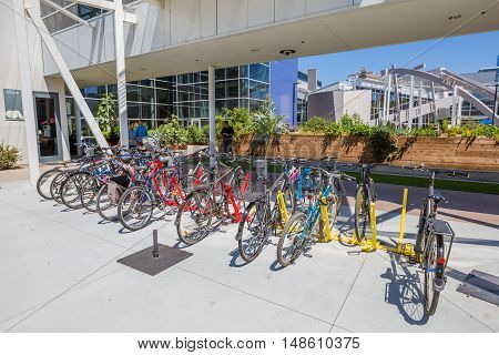 Mountain View, CA, United States - August 15, 2016: bikes used by Google employees to move around the Googleplex. Google is a multinational corporation specializing in Internet services and products.