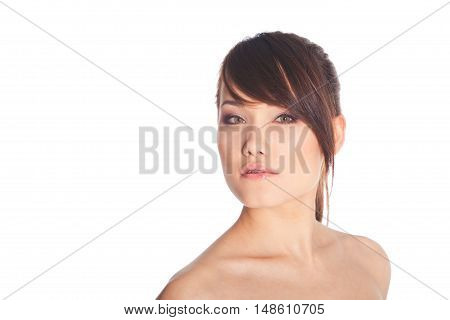 Beautiful young woman with clean skin posing on white background