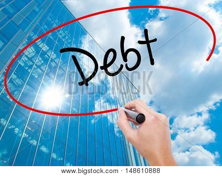 Man Hand Writing Debt With Black Marker On Visual Screen