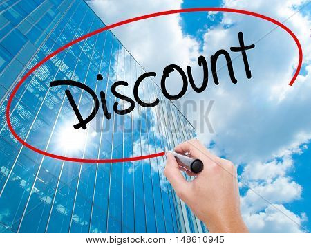 Man Hand Writing Discount With Black Marker On Visual Screen