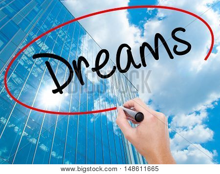 Man Hand Writing Dreams With Black Marker On Visual Screen