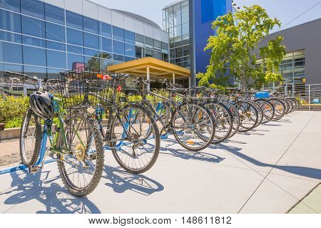 Mountain View, California, United States - August 15, 2016: the famous bikes used by Google employees to move around the Google headquarters, also called Googleplex. Google bicycle in its campus.