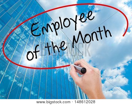 Man Hand Writing Employee Of The Month  With Black Marker On Visual Screen