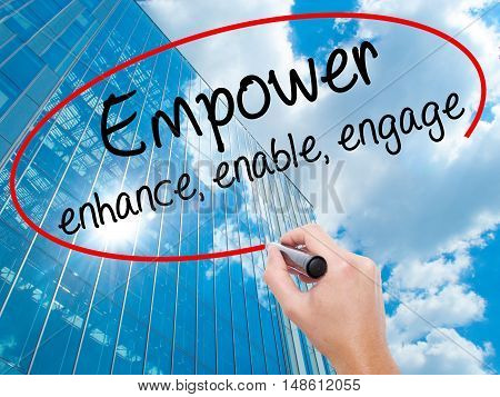 Man Hand Writing Empower Enhance, Enable, Engage With Black Marker On Visual Screen