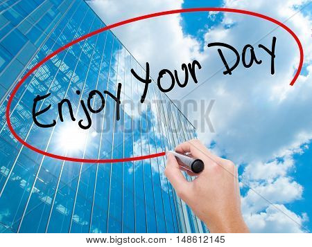 Man Hand Writing Enjoy Your Day With Black Marker On Visual Screen