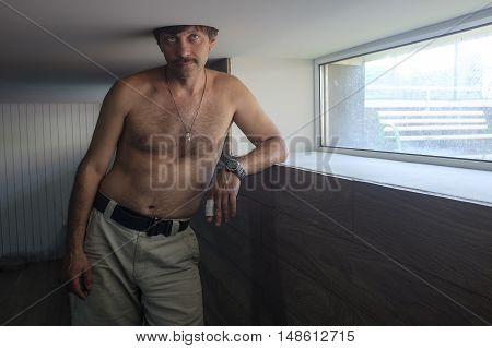 room, his head in a hole in the ceiling, chest hair, strange,