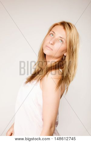 Skin care. Attractive blonde woman with no makeup fresh face with natural make up on gray