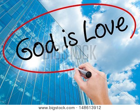 Man Hand Writing God Is Love With Black Marker On Visual Screen