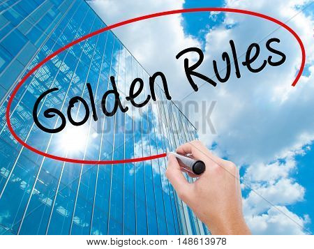 Man Hand Writing Golden Rules With Black Marker On Visual Screen